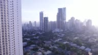Residential and commercial buildings stand in the Makati district of Manila the Philippines on Thursday Feb 2 Pan left to right from the Jazz...