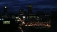 Residential and commercial tower blocks stand on the city skyline at dusk in Johannesburg South Africa on Wednesday Dec 18 The central business...