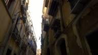 POV Residential buildings in narrow street of Palermo