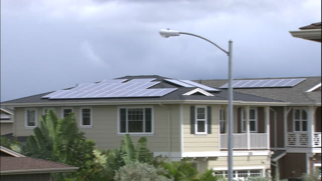 Residential homes have solar panels on their roofs