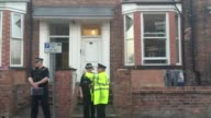 Residents are permitted to move beyond the police cordon on Springfield Street in Wigan following a police raid and police officers continue to guard...