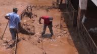 Residents of Barra Longa start cleaning extensive damage up after mudslide disaster