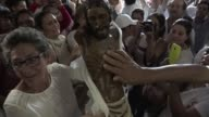 Residents of Bojaya arrive in Villavicencio with their town's Christ statue which will receive a blessing from Pope Francis