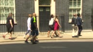 Residents of Grenfell Tower walking into 10 Downing Street
