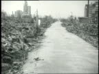 Residents of Hiroshima walk through the city in ruins