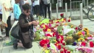 Residents of Munich leave flowers and candles at the shopping mall where David Ali Sonboly a young German Iranian man killed nine people and injured...