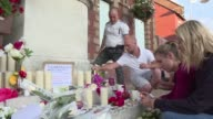 Residents of the French village of SaintEtienneduRouvray express disbelief sadness and anger after a local priest was killed in an attack claimed by...
