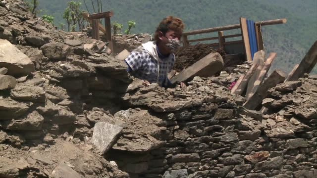 Residents of the hilltop village of Barpak salvage what they can from their destroyed homes as they wait for help to rebuild their lives after...