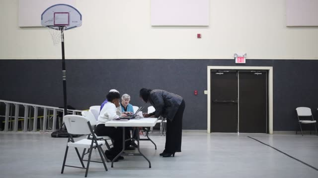 Residents vote in the South Carolina Democratic presidential primary election at a polling station inside the First Pentecostal Church in Clinton...