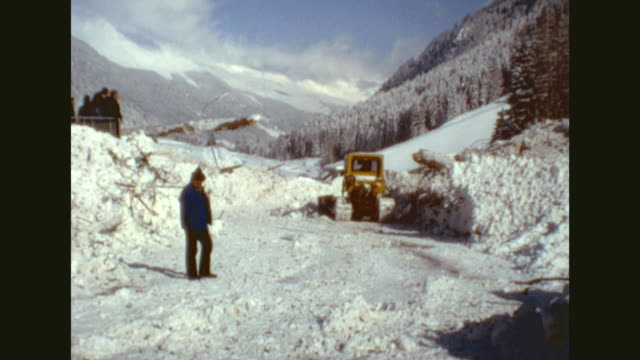 Resort town of Ischgl under a heavy layer of snow / views destruction in the village caused by an avalanche people looking at the debris field of the...