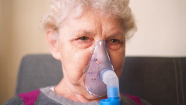 Respiratory oxygen nasal catheter to senior woman