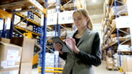 Responsible manager with tablet in warehouse