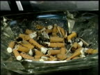 Restaurant chain bans smoking ITN Woman smoking cigarette Cigarette stubbed out in ashtray