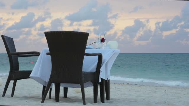 Restaurant table on beach, in tropics