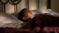 Restless boy in bed