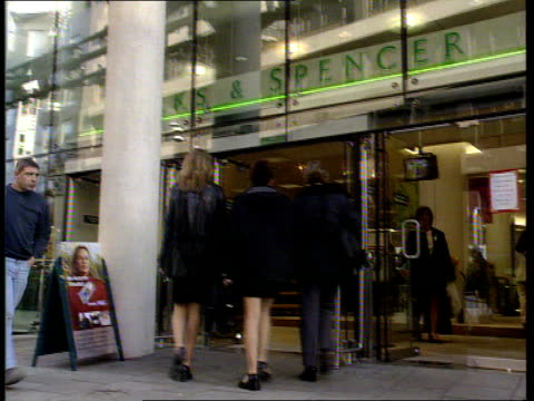Results to be announced ITN ENGLAND London EXT Marks and Spencer store TILT DOWN entrance Shoppers in store looking at clothing