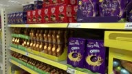 General views of Tesco Metro store ENGLAND London Tooley Street EXT Cadbury Easter eggs on shelves in Tesco Metro store / customer looking at...