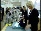 Marks Spencer appoint new designer ENGLAND London Customers at sales desk in branch of Marks Spencers Customers in shop LIB