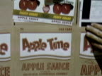 TU Retail packaging with logo and labels for apple sauce are displayed / Sebastopol, California, United States