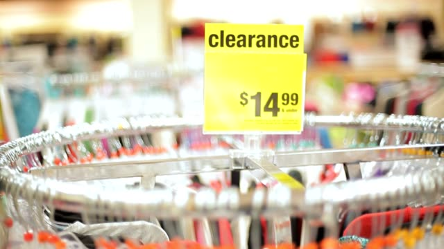 Retail Store Shopping Clothing with Clearance Price tag