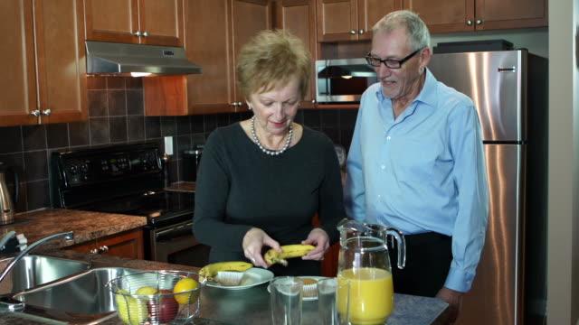 Retired seniors in love, enjoy breakfast.