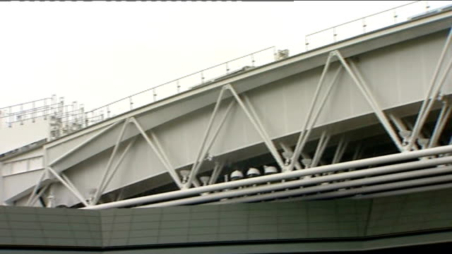 Retractable roof unveiled at Wimbledon's Centre Court ENGLAND London Wimbledon All England Club EXT General views of new sliding roof and crowds...