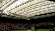Retractable roof unveiled at Wimbledon's Centre Court Roof in closed position male opera singers perform song from centre of court SOT
