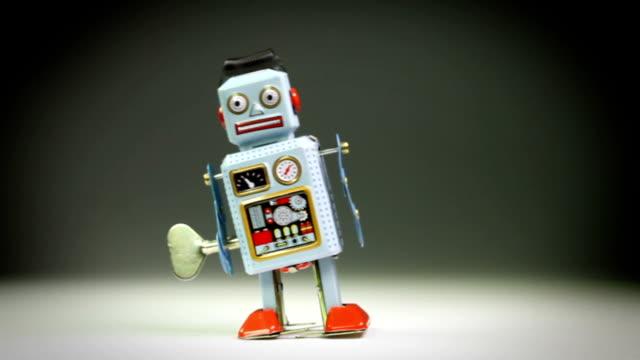 Retro tin toy robot falls down