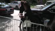 Retta greets a fan while arriving at LA KingsNY Rangers Game 2 at Staples Center on June 07 2014 in Los Angeles California