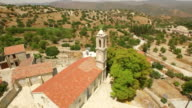 Revealing aerial shot of a church in Cyprus