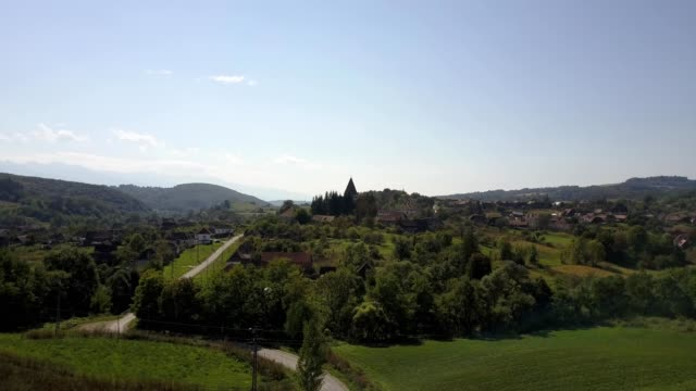 Revealing shot of the fortified church in Somartin