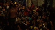 Revellers dance to AfroBrazilian music at a downtown Rio street carnival or Bloco on February 19th 2017 in Rio de Janeiro Brazil