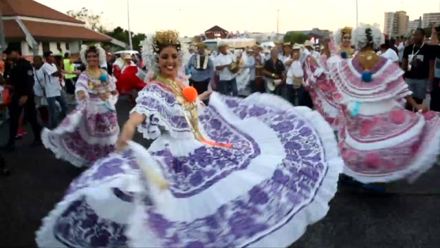 Revellers take part in a carnival celebrations in Panama City