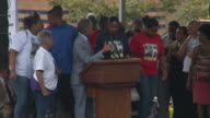 Reverend Al Sharpton stands with the family of victim Eric Garner at the 'We Will Not Go Back March For Justice' rally / Sharpton introduces Garner's...