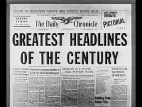 "Reverse angle typesetting frame as VO typewriter sounds letters appear individually to form mirror image of words ""Greatest Headlines"" on one row and..."