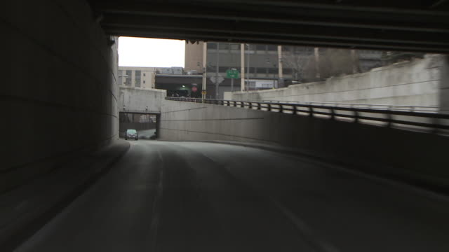Reverse POV driving up on the lead in ramp to the Lincoln Tunnel from 30th street to the tunnel entrance