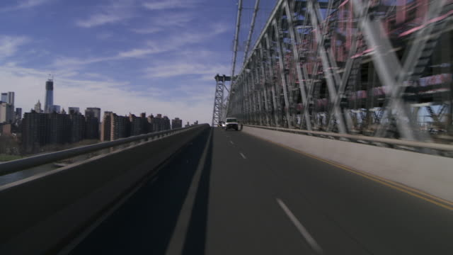 Reverse POV of the Williamsburg Bridgee headed to Brooklyn, the Freedom Tower and apartmetns are featured to the left.