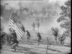 Revolutionary War soldiers march on a path / closer in on group of revolutionary soldiers marching / Soldiers recreate scene from War of 1812 an...