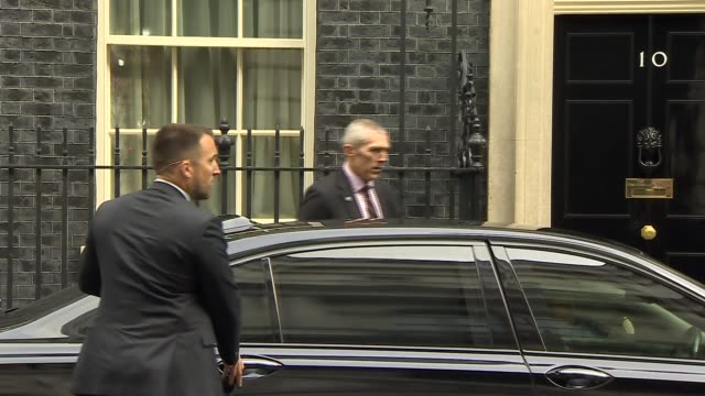 Rex Tillerson departs Downing Street ENGLAND London Downing Street INT Rex Tillerson leaving Number Ten and into car / car away / others leaving No...