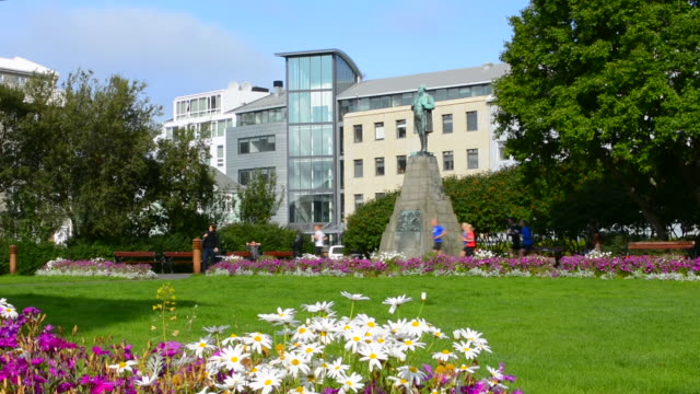 Reykjavik Iceland downtown colorful park with flowers in city center in summer sunshine