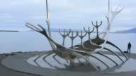 Reykjavik Iceland downtown Harbor Sculpture Sun Voyager Viking Ship artist Jon Gunnar Arnason with fisherman
