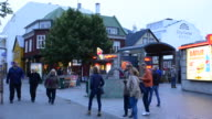 Reykjavik Iceland downtown twilight of streets and tourists walking around restaurants and night spots