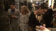 Reza Farahan and Asa Soltan Rahmati sign for and pose with fans in the lobby of NBC Studios in Rockefeller Center Celebrity Sightings in New York NY...