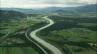 AERIAL Rhine river crossing Appenzell mountains valley, Switzerland