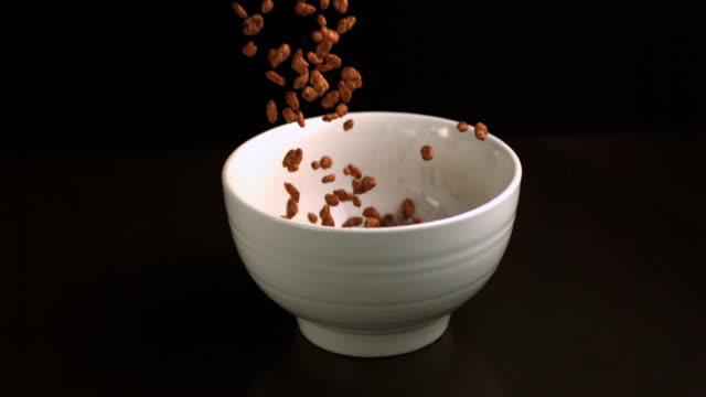 Rice cereal pouring into a bowl