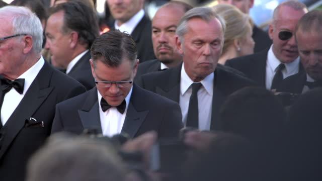 Richard LaGravenese Michael Douglas Greg Jacobs Steven Soderbergh Jerry Weintraub Matt Damon posing for paparazzi on crowded red carpet at Grand...