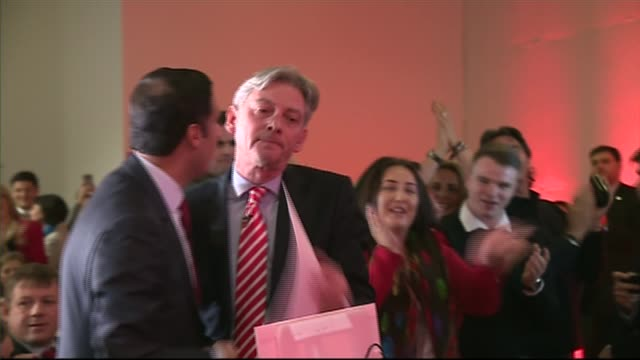 Richard Leonard elected as the new leader of Scottish Labour Party SCOTLAND Glasgow INT Richard Leonard hugging man and along to podium