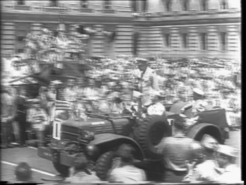 Ride shot past crowd standing on Capitol steps / wounded veterans cheer / Dwight D Eisenhower jeep rides past Capitol / jeep stops in front of...