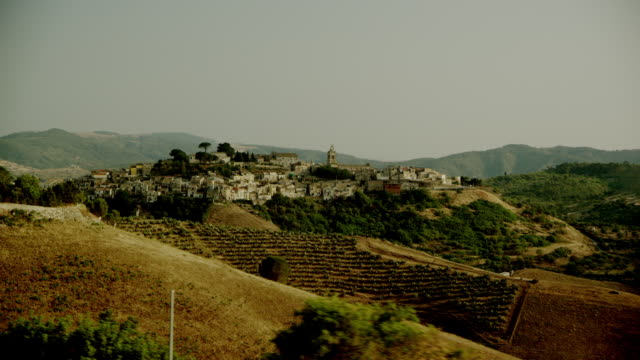 Ride through Italian landscape with view on a village