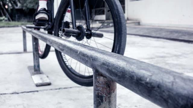 BMX rider grinds on rail